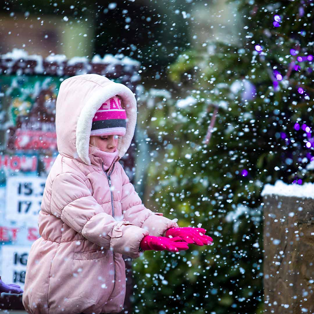 Girl in snow at Chessington Resort